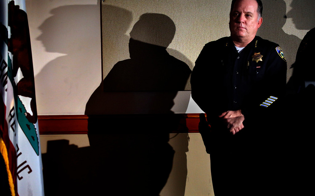 . Santa Cruz Police Chief Kevin Vogel watches the showing of dash-cam video during a press conference at Police Headquarters about the officer-involved fatal shooting of Sean Arlt.