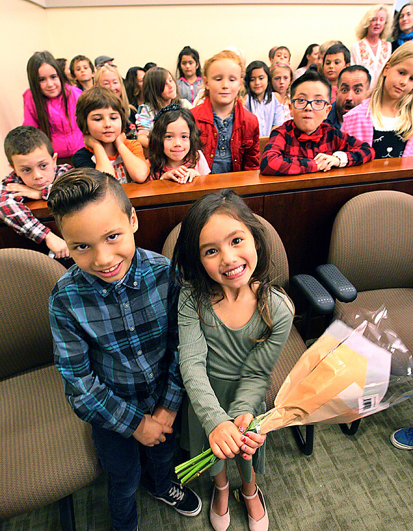 . Weston and his sister Winter stand in Judge Rebecca Connolly\'s courtroom before being adopted by Lani and Scott Almand of Aptos on Friday, while Weston\'s classmates from Mar Vista Elementary watch from the gallery. (Dan  Coyro -- Santa Cruz Sentinel)