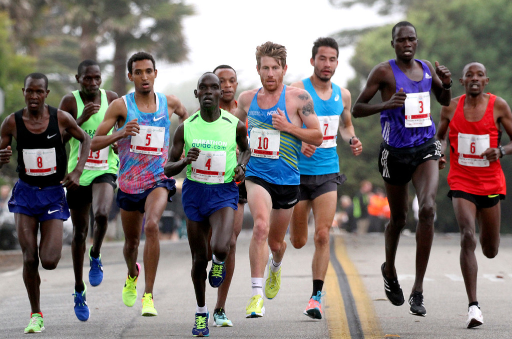 . The men\'s lead pack remained at nine runners throughout much of Sunday\'s Wharf to Wharf Race, including winner Teshome Mekonen, third from left, and top American finisher Diego Estrada Constantino, third from right. (Shmuel Thaler -- Santa Cruz Sentinel)
