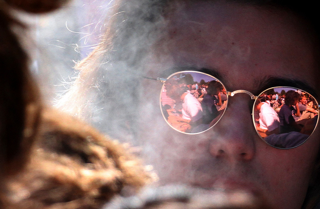 . The marijuana party festivites of the annual 420 celebration at the Porter Meadow at UC Santa Cruz are reflected in the sunglasses of a reveler on April 20, 2017 in Santa Cruz, California.