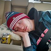 JD sleeping in the car from California home to Oregon, Christmas, 2017