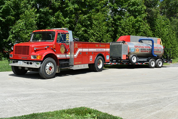 "Keplinger Repair Service - Winchester, Virginia. ""10"" is a 1997 International 4900/2011 Keplinger/Knapheide pulling a mobile pump test trailer.  The International came from Orkney Springs, Virginia and once was a 1997 International/1998 LSI/1976 John Bean 500/1250 fire truck."
