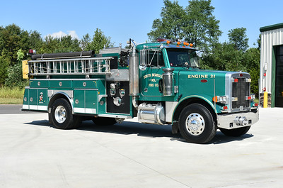Officer side of Engine 21, a 1990 Peterbilt 379/E-One/American Eagle 1750/1000.