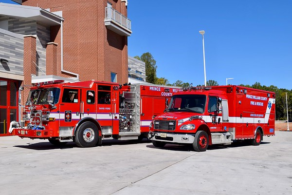A group photo of Engine (2016 Pierce Arrow XT) and Medic 526 (2015 Freightliner/Wheeled Coach) behind FS 26.  October 2017.
