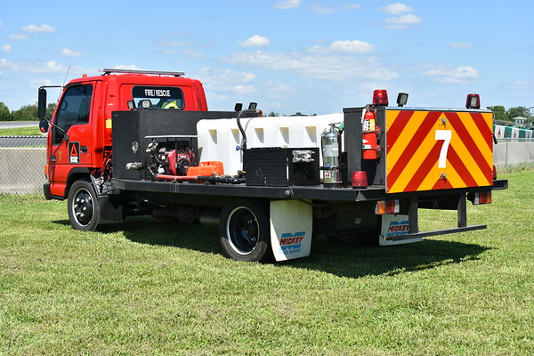 A back end view of number 7, a 2004 GMC W4500 (Isuzu)/Mickey Truck Bodies.  The large compartment in the back carries extrication tools.