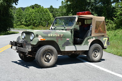 """District 16's Brush 7-2, a 1986 AMC Jeep CJ 5/FD with a 10/50.  Received through the Maryland DNR.  The front hood says """"Git R Done""""."""