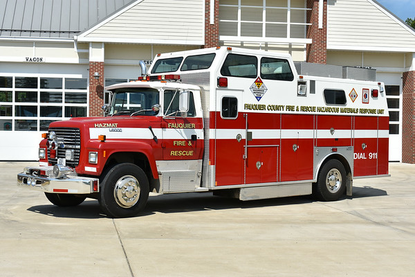 Fauquier County's unusual HAZMAT 10 assigned to the New Baltimore, Virginia station.  The county received this truck in 1998 and it has run as HAZMAT 1, 3, and 7.  It is a 1993 Ford L9000/1994 Marion/1998 LSI.  It was originally one of nineteen trucks built for San Paulo, Brazil, however they were never delivered.  As a result, a variety of the trucks made their way into service at U.S. stations, including Fauquier County.  The trucks were modified in a variety of ways, including the removal of a number of labels that had to be written in English.  HAZMAT 10 was photographed at the New Baltimore station in August of 2017.