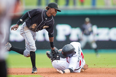 Austin Meadows slides under the tag of Jose Vinicio as the Indianapolis Indians take on the Charlotte Knights at Victory Field on May 9, 2017. (Photo credit: Dave Wegiel/MiLB.com