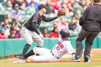 Austin Meadows slides under the tag of Nicky Delmonico at third base as the Indianapolis Indians take on the Charlotte Knights at Victory Field on May 9, 2017. (Photo credit: Dave Wegiel/MiLB.com