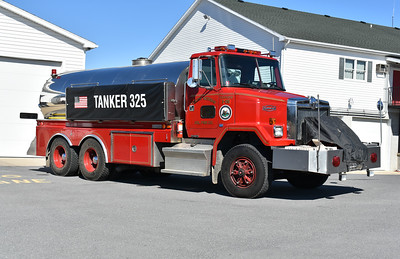 Dressed for winter protection with a cover over the front mount pump is South Morgan's Tanker 325, a 1990 AutoCar WCM 64/4-Guys with a 1000/4000 and 4-Guys serial number F-1199.