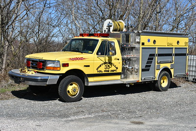 Photographed at a fire apparatus shop in Hagerstown, Maryland is Sistersville (Tyler County), West Virginia - a 1995 Ford Super Duty/4-Guys 500/250 with 4-Guys serial number F-1649.