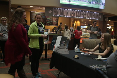 Student Author, Jen Guberman, greets students as they arrive at her Book Release party for her second book in the Eos Dawn Series, Fortitude.