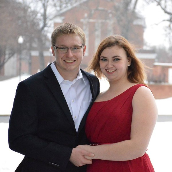 Justin Conklin and Alexis Starnes pose for pictures in the snow in preparation for tonight's Winter Formal.