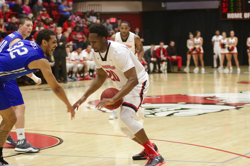 On Thursday night at 9:00pm Gardner-Webb Men's Basketball took on UNC Asheville in a slammed packed game that was nationally televised on ESPNU. Students from GWU as well as UNC Asheville, community members, and faculty filled the entire arena to support the Running Bulldogs in their 81-76 win during their last home game of the season.