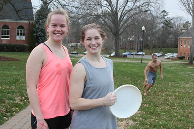 Students Mackenzie Ropka and Tessa Walsh love the warm February weather, and enjoy playing frisbee in the quad.
