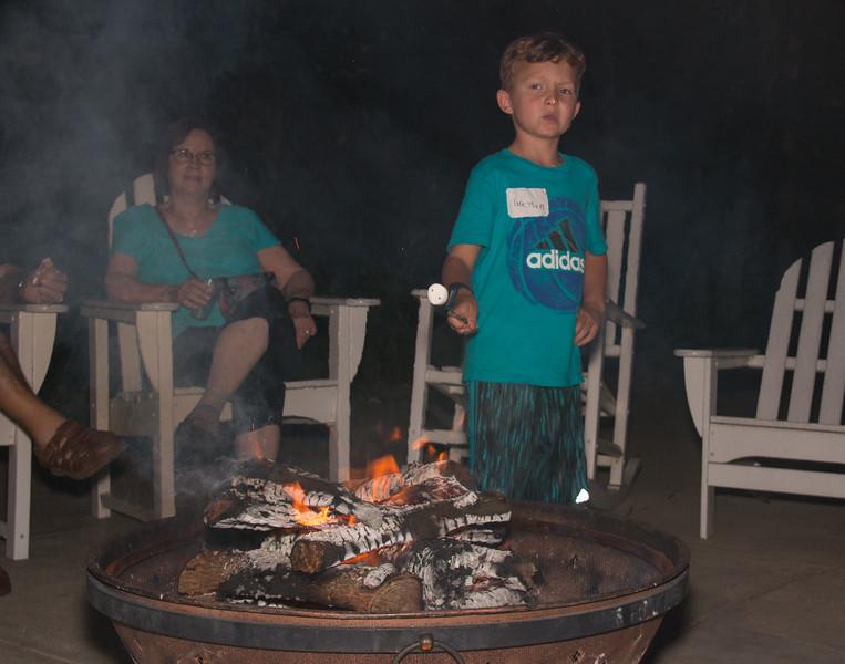 Greysen Maas toasting a marshmallow