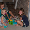 Greyson Maas, Johanne Mardis and Maci Miller, playing Hungry Hippos