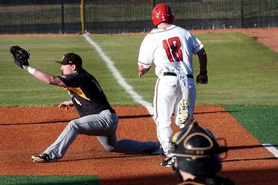 Matt Simmons runs to first base