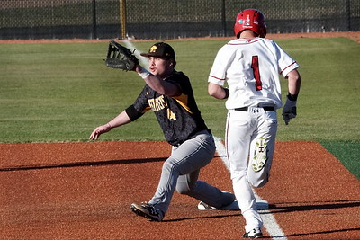 Evan Hyett runs to first base