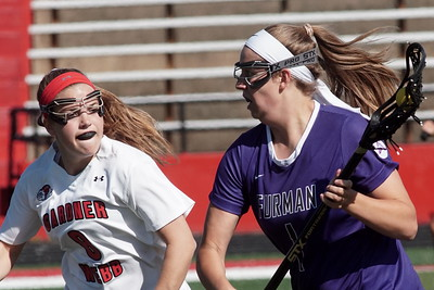 Amanda Steinmuller defends against a Furman player