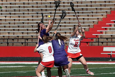 A fight for the ball between GWU and Furman