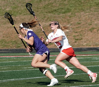 Abby Hanscom defends against Furman
