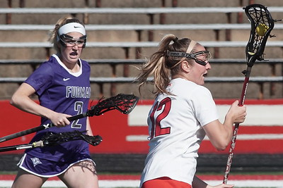 Lindsey Lippert rruns past a Furman player