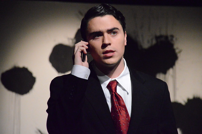"Freshman, RJ Thompson, takes a phone call in a scene of ""God of Carnage"" a show being put on by Gardner-Webb's theater department."