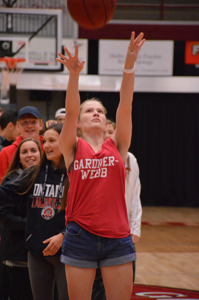 Abbey Vowell attempts a free throw shot at half time of the Men's Basketball Game to try and win a prize.