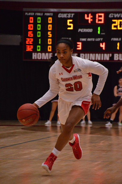 Junior Guard Ky'Asia Stanford takes the ball down the court to score and lead the Women's Basketball Team to a victory over USC Upstate.