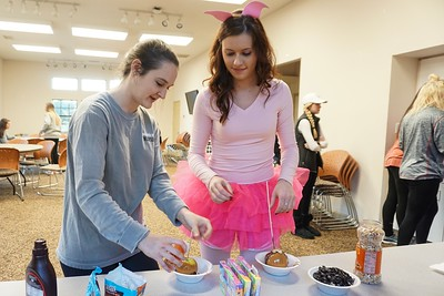 Hope Johnston and Megan McDaniel add delicious toppings to their apples.