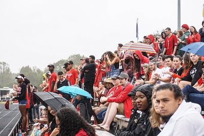 Even in the rain, students cheer on their team.