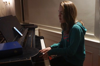 Haddie Winters playing piano in the chapel