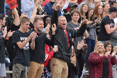 Peden Warlick, Codi Slayton and John Daugherty lead the student section in cheers over a Bull Dog Touchdown!