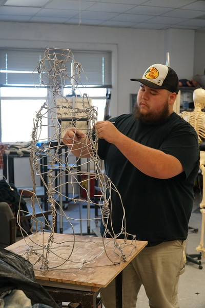 Dylan Camp working on one of his art projects in the studio.