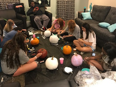 Jessica Gordon, Ana Gutierrez, Sam Kane, Russell Hughes, Sydney Huggins, Katie Wilkerson, Kaylee Henning, and A'leicia Simpson paint pumpkins to get in the fall spirit.