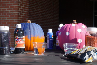 Students got to choose from an array of brushes, paints, and glitter for their pumpkins.