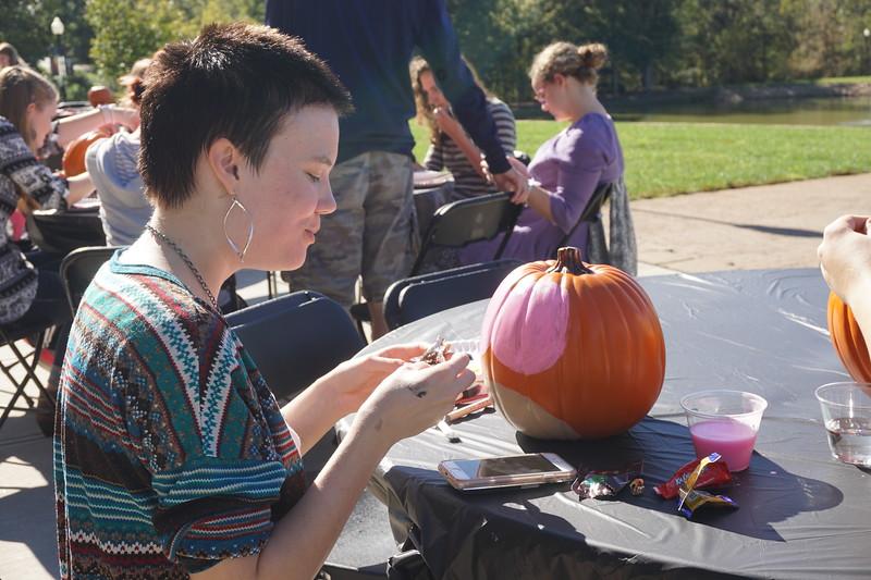 Angela Meade beginning to paint her owl pumpkin