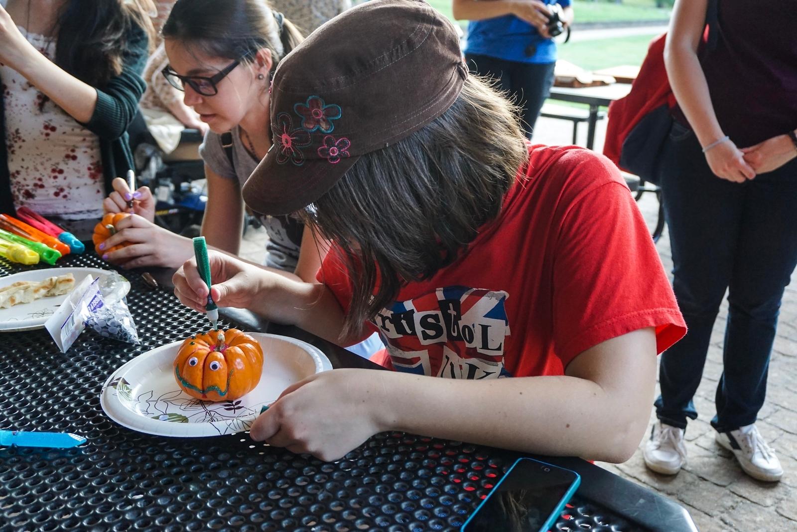 Meg Hibbitts decorating a pumpkin