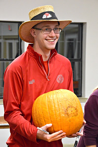 Cory Meigs shows off his pumpkin art to his friends.