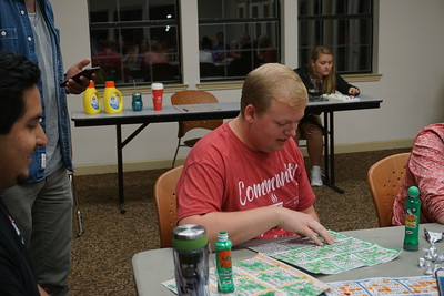 Nate Allman reads off his numbers while Cassidy McDowell confirms his bingo win