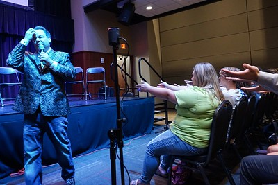 Hypnotist shows students the power of suggestion.