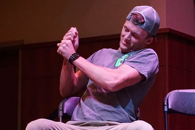 Student casts his imaginary reel-- the hypnotist told the volunteers they were fishing.