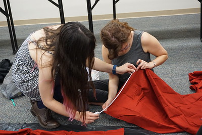 Blaire Pope and Lexi Keller work together to measure the fabric.