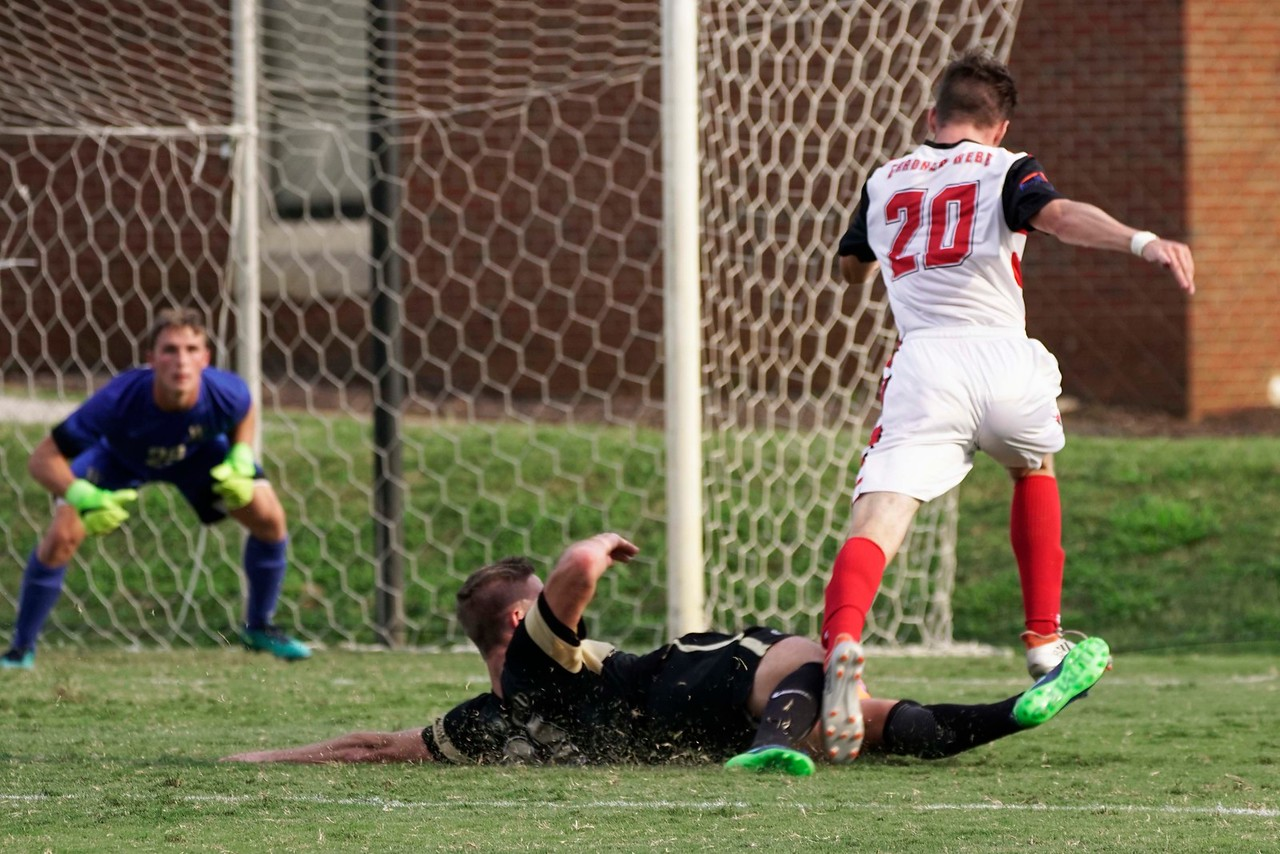 Marc-Kevin Schwenk #20 before scoring the final point for GWU