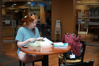 """Nursing student, Ashton Knotts, grabs a quick lunch while studying."""