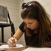 Senior ASL major, Morgan Ransom, spends her Saturday in the library, watching Interpreting videos and taking notes for her senior level interpreting class.