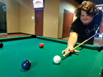 Eddie Mote, Sophomore, takes a break from studying to play some pool in the Tucker Student Center