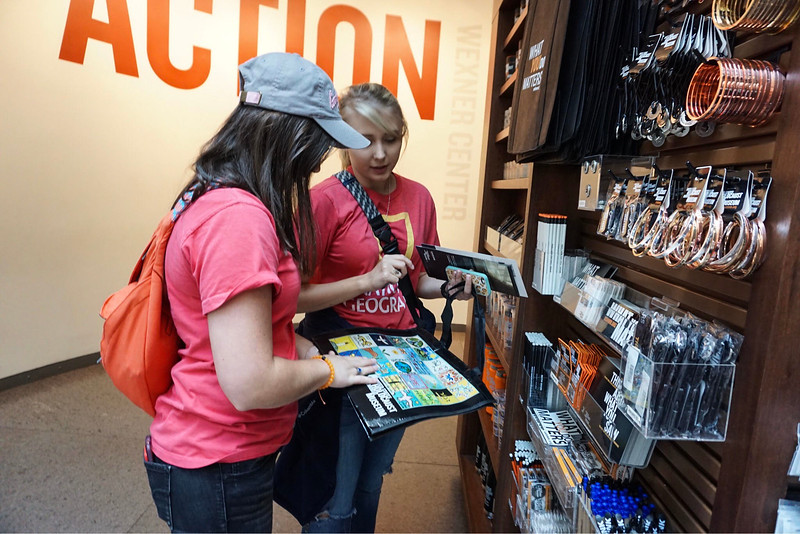 Students Tori Collie and Summer Byers look at souvenirs at the United States Holocaust Memorial Museum.