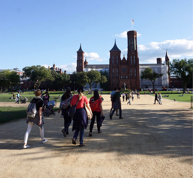 Students walk towards the Smithsonian Institute.